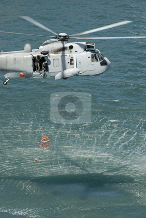 Rescue Helicopter stock photo, An Australian navy sea king helicopter practising a rescue by Stephen Gibson