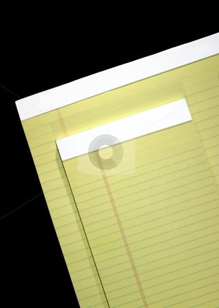 Writing Tablet stock photo, Two yellow notepad with lines on a black background. by Henrik Lehnerer