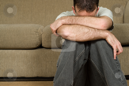 Depression stock photo, A young man sitting on the floor suffering from clinical depression by Richard Nelson