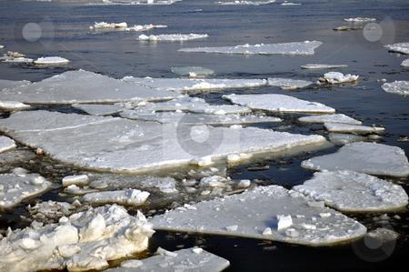 Ice blocks in river stock photo, Winter scenery, ice blocks floating on river. by Fernando Barozza