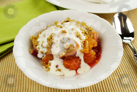 Fruit Crumble stock photo, Seasonal fruit crumble dessert with cream ready to serve. by Brett Mulcahy