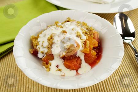 Fruit Crumble stock photo, Seasonal fruit crumble dessert with cream ready to serve. by Brett Mulcahy