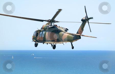 Army Blackhawk stock photo, Australian Army Blackhawk chopper flies over the Pacific Ocean. by Brett Mulcahy