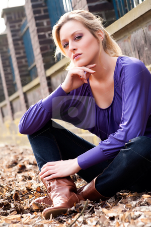 Sitting against the wall stock photo, Young blond girl outside on a street posing against the wall by Frenk and Danielle Kaufmann