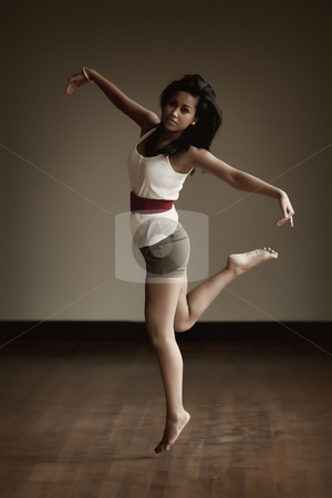 Portrait of an Indonesian girl dancing stock photo, Jumping and dancing beautifull Indonesian girl by Frenk and Danielle Kaufmann