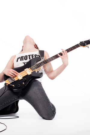 Rocking bending backwards stock photo, Young female bass guitar player specially isolated on white by Frenk and Danielle Kaufmann