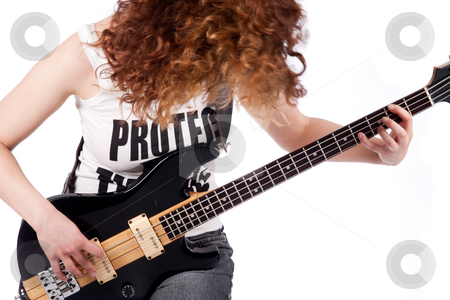 Lets rock it stock photo, Young female bass guitar player specially isolated on white by Frenk and Danielle Kaufmann
