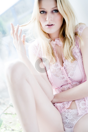 Bright lingerie stock photo, Young blond girl posing in lightpink lingerie nearby a bright window by Frenk and Danielle Kaufmann
