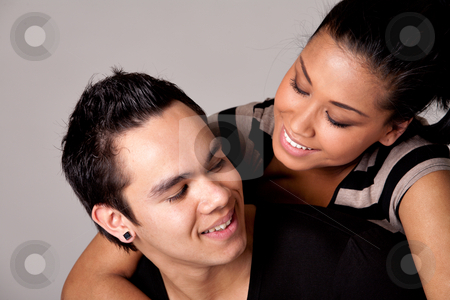 Checking out my Indonesian lover with a smile stock photo, Portrait of Indonesian boy- and girlfriend in love by Frenk and Danielle Kaufmann