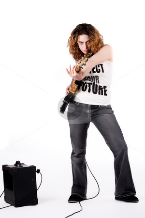 Pump up the bass stock photo, Young female bass guitar player specially isolated on white by Frenk and Danielle Kaufmann