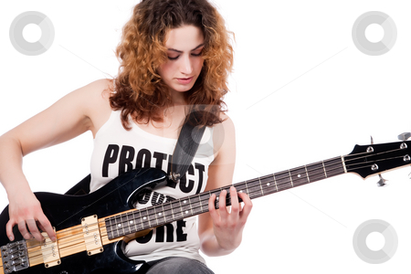 Play on my guitar stock photo, Young female bass guitar player specially isolated on white by Frenk and Danielle Kaufmann