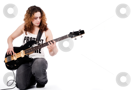 Me and my music stock photo, Young female bass guitar player specially isolated on white by Frenk and Danielle Kaufmann