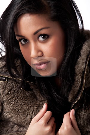 Young beautifull African woman in fur jacket stock photo, Fashion portrait of a young beautifull african woman by Frenk and Danielle Kaufmann