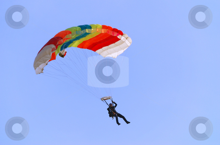 Parachutist turning right stock photo, Parachutist pulling right handle and turning right. by Ivan Paunovic