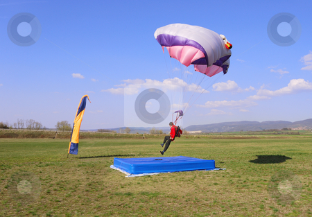 Right in the center stock photo, Parachutist landing right in the center of a target. by Ivan Paunovic