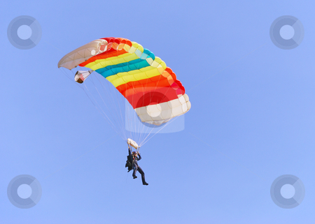 Colorful parachute stock photo, Colorful parachute against clear sky in background. by Ivan Paunovic