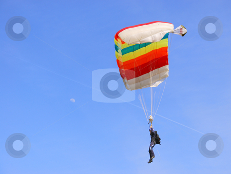 Colorful parachute stock photo, A colorful parachute in a blue sky on a sunny day by Ivan Paunovic