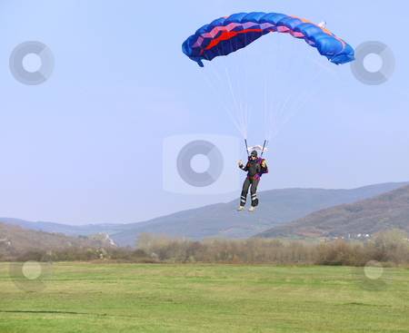 Parachutist landing stock photo, Parachutist landing on a field after good flight. by Ivan Paunovic