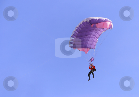 Purple parachute stock photo, A purple parachute in a blue sky on a sunny day. by Ivan Paunovic