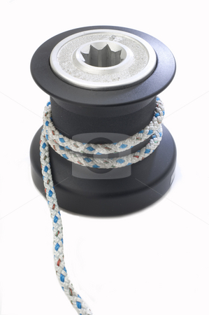Sailboat winch stock photo, Sailboat winch with line wrapped around by Jonathan Hull