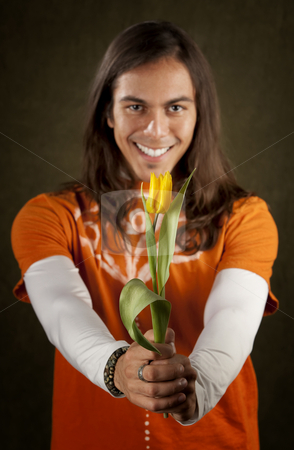 Handsome Man with Yellow Flower stock photo, Handsome man reaching out with yellow tulip flower by Scott Griessel
