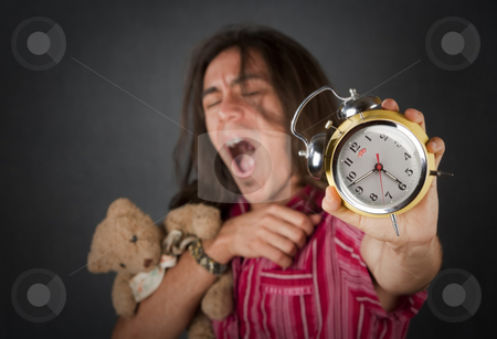Sleepy Young Man stock photo, Sleepy handsome young man with long hair and alarm clock by Scott Griessel