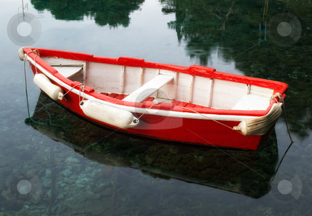 Red wooden boat stock photo, Old retro wooden boat on a calm sea surface. by Sinisa Botas