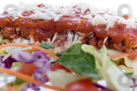 High key Close up shot of Lasagna stock photo, High key Close up shot of Lasagna with salad - selective focus on Lasagna (background) by iodrakon