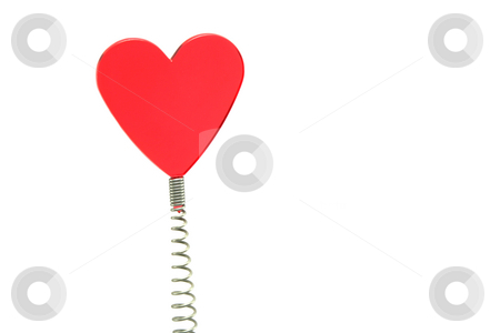 Red Glass Heart on Spring stock photo, A red glass heart on a spring - novelty placemarker by Helen Shorey