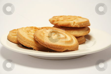 Shortbread on a plate stock photo, Six shortbread biscuits on a china plate. Neutral background. Focus in on front 2 biscuits. by Helen Shorey