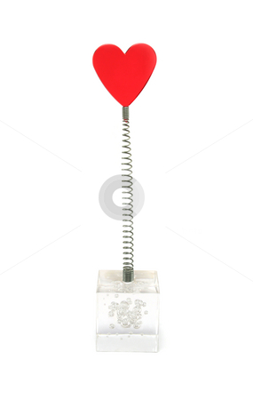 Red heart on a Spring stock photo, Red glass heart on a spring, set into a clear perspex block filled with air bubbles - used as a novelty placemarker by Helen Shorey