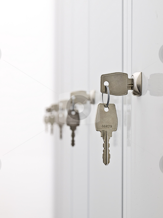 Keys and the locker doors stock photo, Keys in the row hanging from the locker doors,shallow DOF by Vladimir Koletic