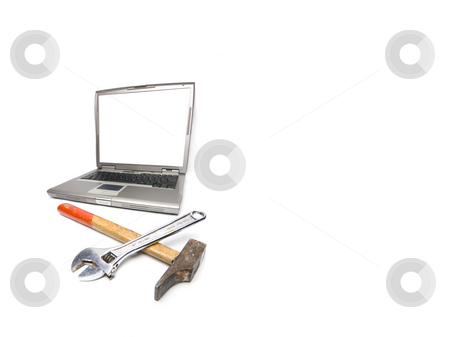 Laptop and tools stock photo, Conceptual technology and help. Computer and tools. by Ivan Montero