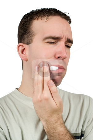 Tooth Pain stock photo, A man suffering from a toothache and holding some cotton in his mouth to help, isolated against a white background by Richard Nelson