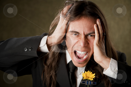 Handsome man in formalwear screaming stock photo, Handsome man screaming in formal jacket with boutonniere by Scott Griessel