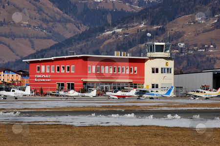 Zell tower in Winter stock photo, Zell am See (LOWZ) tower seen in February with parked aircrafts in front by Alexander Gerzabek