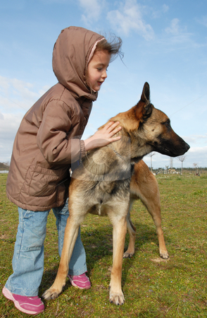 Little girl and malinois stock photo, Little girl and her belgian shepherd malinois by Bonzami Emmanuelle
