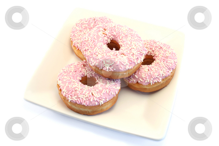 Four Iced Doughnuts with Sprinkles stock photo, Iced donuts amd sprinkles on a cream china plate by Helen Shorey
