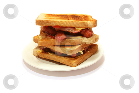Toasted Bacon Sandwich stock photo, Yummy Bacon sandwich using toast, with butter and ketchup oozing by Helen Shorey