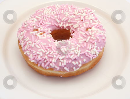 Iced Donut stock photo, Single lonely iced donut on a plate by Helen Shorey