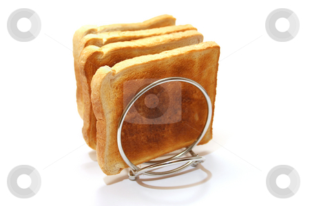 Toast Cooling stock photo, Four slices of toast on a stainless steel toast rack by Helen Shorey