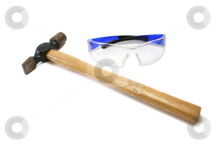 Hammer and Safety Glasses stock photo, Hammer and safety glasses. Hammer has an old warning sticker but it's message has been lost with use. by Helen Shorey