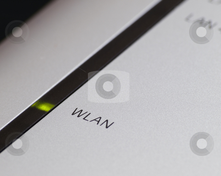 Wirelessly connected stock photo, Close-up of router with focus on green light and WLAN text , shallow DOF by Vladimir Koletic