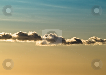 Morning clouds stock photo, Cloud formation divides the sky into blue and orange part , back-lighted with the morning Sun by Vladimir Koletic