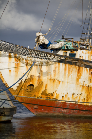 Rusty old tallship stock photo, Old tallship in a dock by Paulo Resende