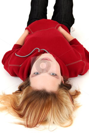 Teenager stock photo, Young girl is lying on white background by Tom P.