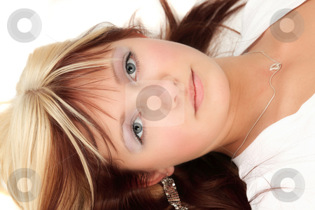 Young blonde stock photo, Cute teenage girl is lying on the flloor by Tom P.