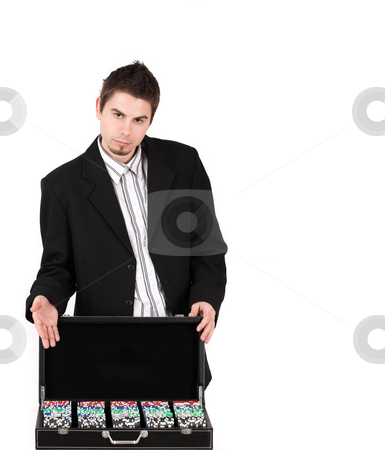 Croupier stock photo, Young man with poker chips tempting for a game by Tom P.