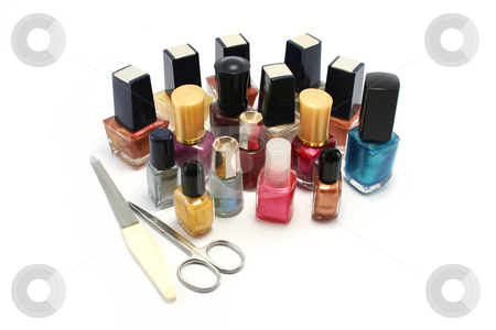Group of Nail Polishes stock photo, A wide selection of coloured nail varnish/polishes with a small scissors and metal nail file by Helen Shorey