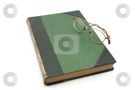 Antiqu Book with Glasses stock photo, Old book (circa 1910) with pair of glasses by Helen Shorey
